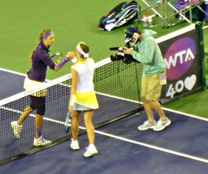 Victoria Azarenka shakes hands with Kirsten Flipkens of Belgium