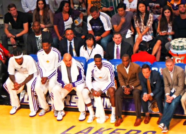 Messers Meeks, Nash, and Blake in their suits with Kobe watching from behind the bench