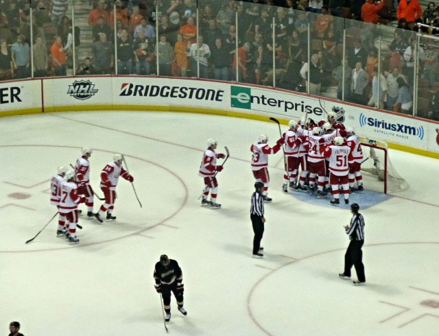 The Wings celebrate while the Ducks skate into the off-season with their tails between their legs