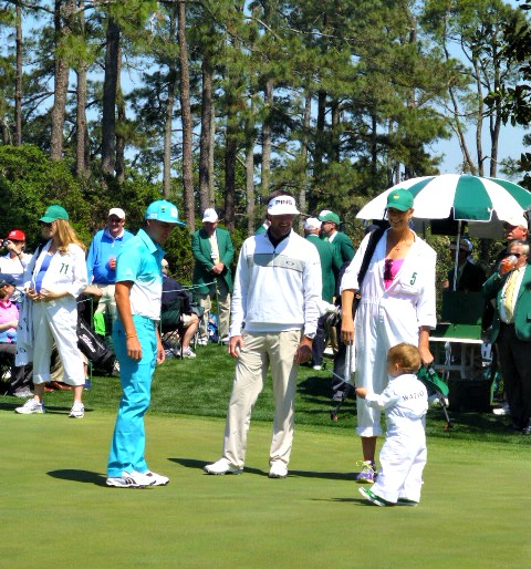 Bubba Watson with his Caddie Wife and kid while Ricky Fowler watches